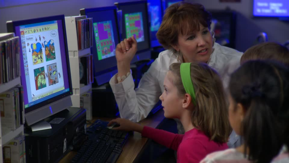 Teacher and Kids Play Computer Game